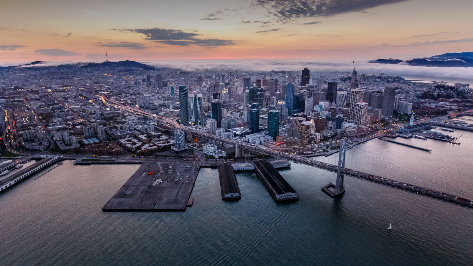 Aerial view looking toward San Francisco with Bay Bridge at sunset